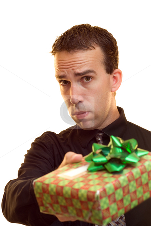 Gift Exchange stock photo, A young man wearing a suit holding out a wrapped present by Richard Nelson