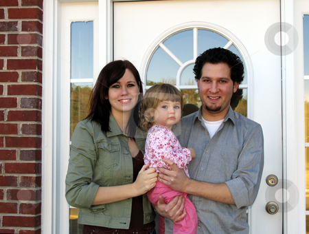 New Home stock photo, Family at the front door of their new home by Anita Peppers
