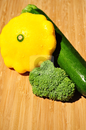Summer Vegetables stock photo, Fresh Brocolie , Zucchini and Patty Pan squash on a Bamboo cutting board by Lynn Bendickson