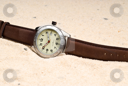 The sands of time stock photo, A watch in sand representing The Sands of Time by Vince Clements