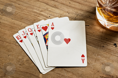 Poker cards and whisky glass. stock photo, Poker cards and whisky glass on old wooden table. by Pablo Caridad