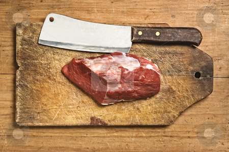 Butcher kife and raw meat, studio shot. stock photo, Butcher kife and raw meat, studio shot. by Pablo Caridad