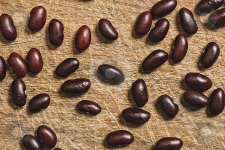 Brown beans. stock photo, Brown beans over an old wooden table. by Pablo Caridad