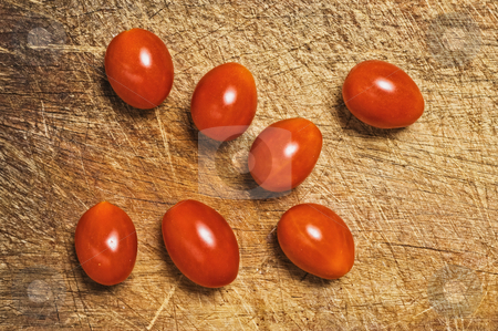 Fresh cherry tomatoes. stock photo, Fresh cherry tomatoes on cutting kitchen board. by Pablo Caridad