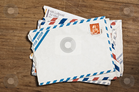 Vintage airmail envelopes. stock photo, Vintage airmail envelopes on an old wooden table. by Pablo Caridad