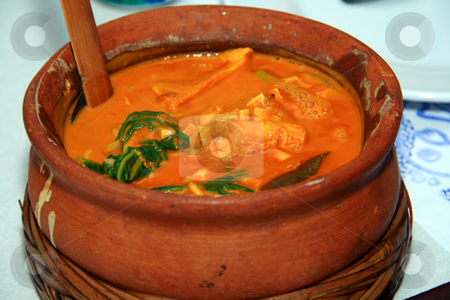 Peanut stew stock photo, Asian peanut stew served in a clay pot by Jonas Marcos San Luis