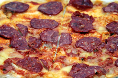 Close-up of pepperoni pizza  stock photo, Close up shot of a pepperoni flavored pizza by Jonas Marcos San Luis