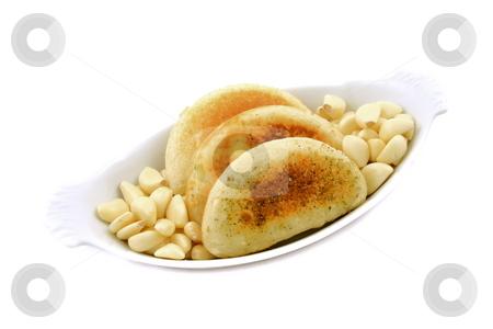 Garlic Rolls stock photo, Garlick cloves with rolls by Jack Schiffer