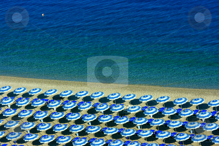 Horizontal beach geometry stock photo, Beach with perfectly parallel lines of parasols, copy-space on the sea by Natalia Macheda