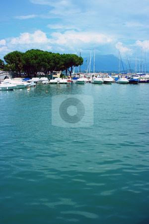 Desenzano skyscape stock photo, Fancy clouds over Desenzano harbor, Garda lake by Natalia Macheda