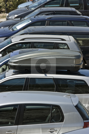 Parking stock photo, Telephoto shot of cars in an ordinary parking lot in touristic resort by Natalia Macheda