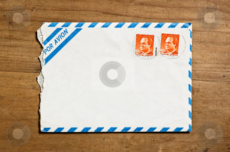 Open air mail envelope. stock photo, Old open air mail envelope over a wooden table. by Pablo Caridad