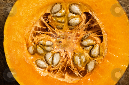 Slice of pumpkin. stock photo, Slice of pumpkin showing seeds, close up shot. by Pablo Caridad