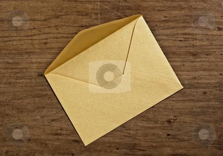 Open golden envelope stock photo, Open golden envelope, close up, studio shot. by Pablo Caridad