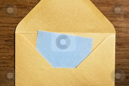 Open golden envelope stock photo, Open golden envelope with blue paper inside. by Pablo Caridad