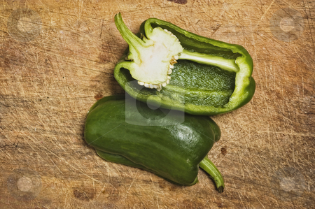 Green bell pepper stock photo, Green bell pepper on old cutting table. by Pablo Caridad