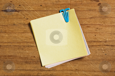 Post it with plastic clip. stock photo, Post it with plastic clip. by Pablo Caridad