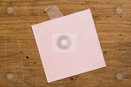 Note pape stock photo, Note paper attached with tape on board. by Pablo Caridad