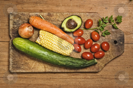 Vegetables on wooden table. stock photo, Vegetables on wooden table. by Pablo Caridad