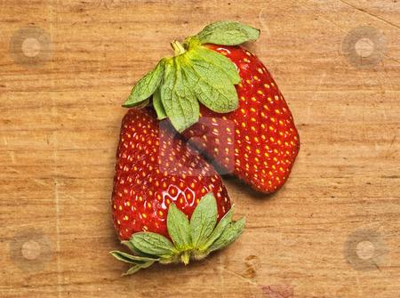 Fresh and tasty strawberries stock photo, Fresh and tasty strawberries isolated on wooden background by Pablo Caridad