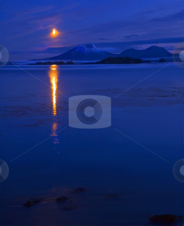Moon Rising over Mt. Edgecumbe stock photo, Mt. Edgecumbe with the moon rising over it, veiled by some thin clouds. Mt Edgecumbe is small dormant volcano that sits in the harbor off Sitka, Alaska. by Mike Dawson