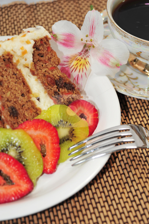 Carrot Cake, Fruit And Coffee stock photo, A slice of Carrot Cake, sliced strawberries and kiwi fruit with a cup of Coffee. by Lynn Bendickson