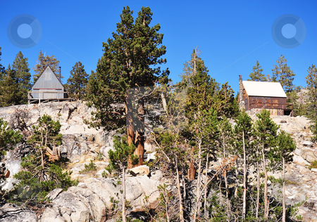Sierra Mountain Cabins stock photo, Two mountain cabins sit atop a solid bedrock hilltop in the California Sierra Nevada Mountains. by Lynn Bendickson