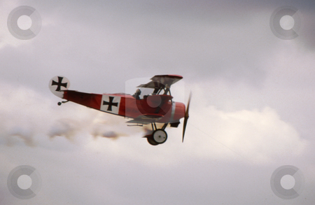 Red Baron stock photo, Triplane, three winged aircraft. Old 'red baron' style by Joseph Ligori