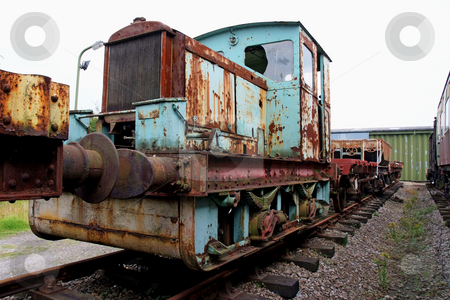 Old-timer stock photo, Vintage diesel powered train being renovated. Rusty condition by Paul Phillips