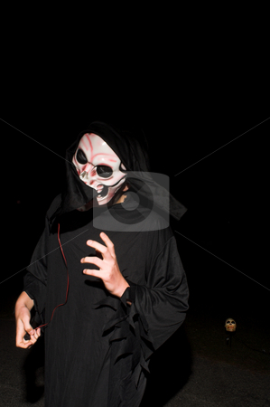 Grim Reaper stock photo, The Grim Reaper roams on Halloween night. by Robert Byron