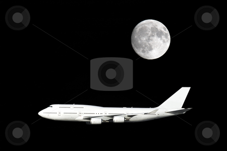 Jumbo jet airplane under full moon stock photo, Large airliner flying under a full moon. by Pierre Landry