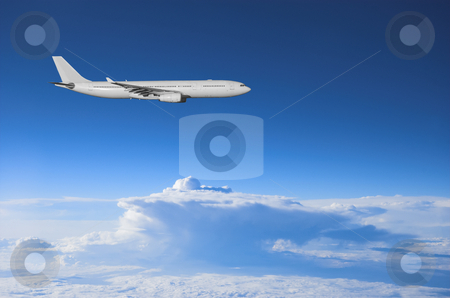 Airliner high above the weather stock photo, Jumbo jet airplane flying high above a thunderstorm by Pierre Landry