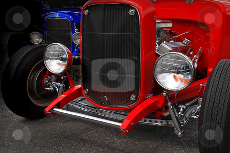 Roadsters stock photo, Flashy 1930 cars in the dark at carshow by Jack Schiffer
