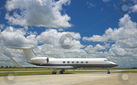 Corporate Jet stock photo, Luxury business airplane  parked at exotic airport by Pierre Landry