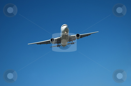 Airliner in blue sky stock photo, Large jet airplane approaching the airport in clear sky by Pierre Landry