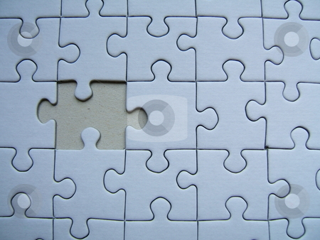 Blue jigsaw puzzle pattern stock photo,  by Gautier Willaume