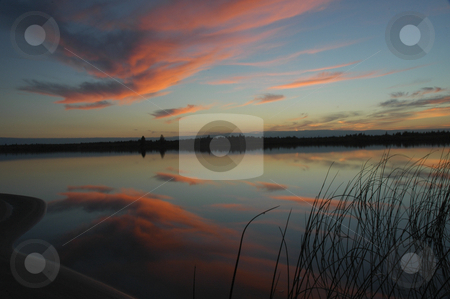 Red Cloud Reflection stock photo, Red clouds reflecting in small northern lake by Pierre Landry