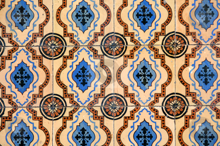 Wall outdoor decorative mosaic stock photo, Traditional ancient mosaic tiles on a house in Lisbon, Portugal, Europe by Gautier Willaume