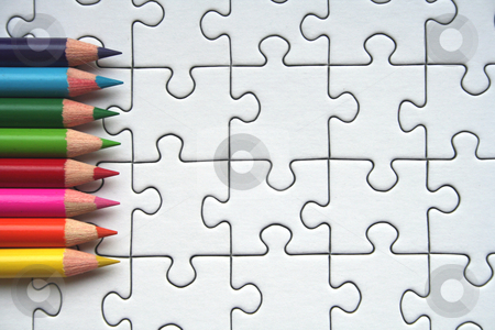 Pencils and jigsaws stock photo, Colorful pencils on white jigsaw pattern by Gautier Willaume