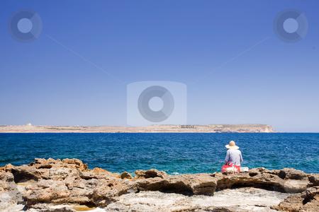 Malta Fisherman stock photo, A maltese fisherman fishing in the sea by Tyler Olson