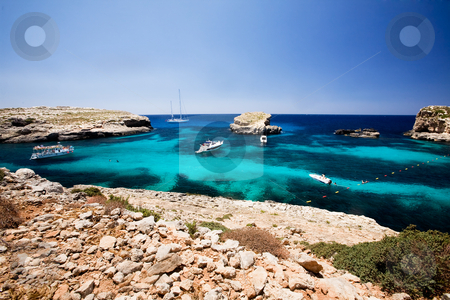 Blue Lagoon stock photo, Blug lagoon on a warm summer day on Comino Island, Malta by Tyler Olson