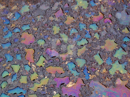 Oil and Water stock photo, Colorful rain drops on oil spot. by Kathy Piper