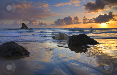 Reflections in the Sand stock photo, Sunset reflects off the wet sand of Indian Beach along the Oregon coast. by Mike Dawson