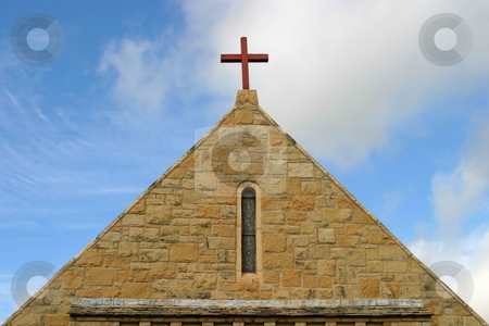 Church Top stock photo, Side view of a church roof with a cross on top by Henrik Lehnerer