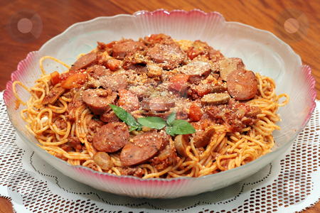 Spaghetti sausage pasta  stock photo, Spaghetti sausage pasta served in a dish by Jonas Marcos San Luis