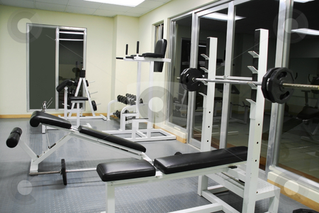 Exercise gym 2 stock photo, Exercise gym with various benches dumb bells and bars by Jonas Marcos San Luis