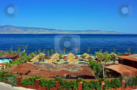 Fancy beach stock photo, Fancy beach with bar near Messina strait in Calabria by Natalia Macheda