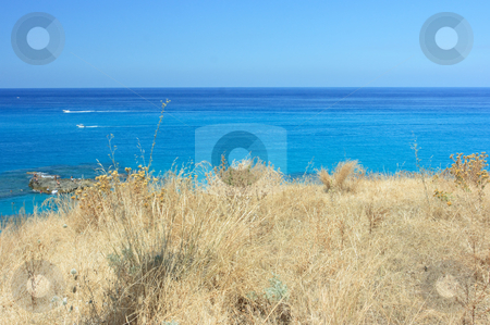 Tropea dry grass stock photo, Typical torrid view of Calabria: extremely dry grass and azzure sea by Natalia Macheda