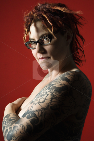 Female portrait stock photo, Side view portrait of adult woman with tattoos. by Iofoto Images