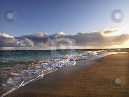 Maui Hawaii beach stock photo, Waves lapping on the beach at dusk in Maui, Hawaii. by Iofoto Images